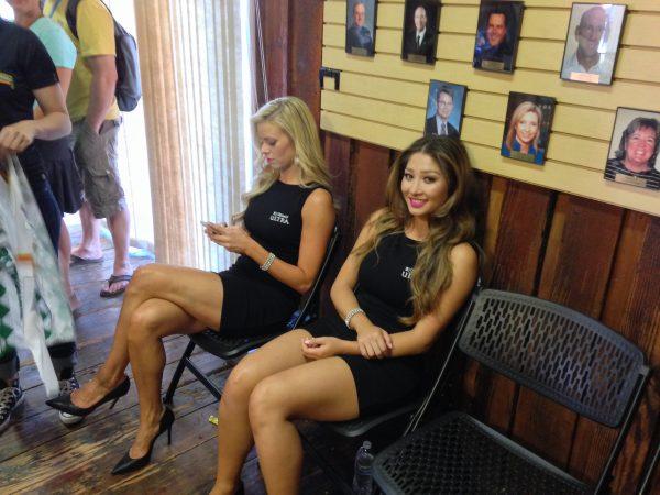 Podium girls in green room.